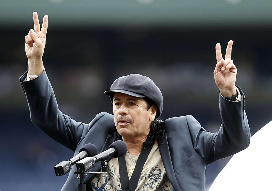Grammy-winning guitarist Carlos Santana gestures after receiving the Major League Baseball Beacon of Change Award during a pregame ceremony during the annual Civil Rights Games before the Atlanta Braves game against the Philadelphia Phillies, Sunday, May15, 2011, in Atlanta. Photo: John Bazemore, AP