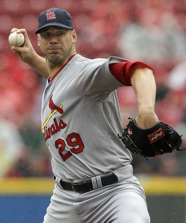 St. Louis Cardinals starting pitcher Chris Carpenter throws to the Cincinnati Reds in the first inning of a baseball game being played in a light rain, Sunday, May 15, 2011, in Cincinnati. Photo: Al Behrman, AP