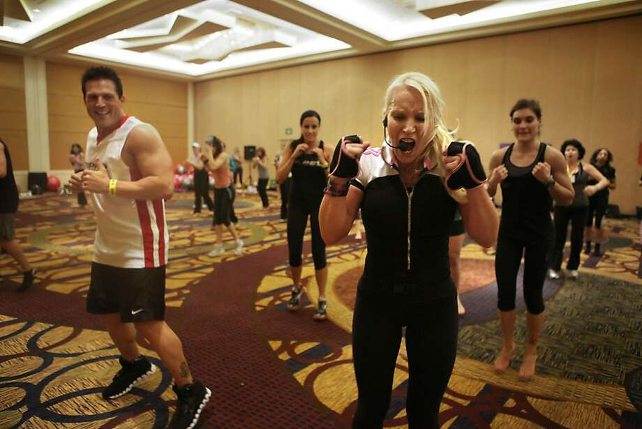 Viveca Jenson (right) introducing piloxing, a workout  merging pilates and boxing, at a health and fitness convention at the Hyatt Regency in Burlingame, Calif., on Friday, March 25, 2011. Photo: Liz Hafalia, The Chronicle