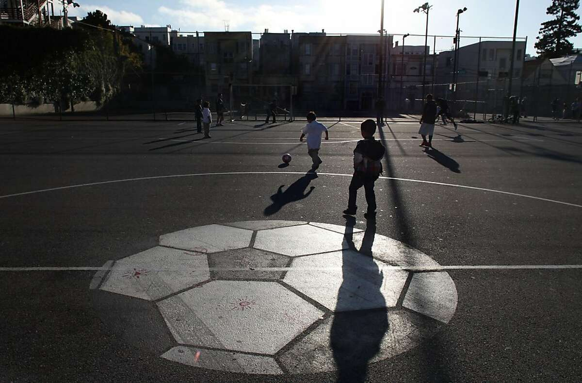 As part of park-wide renovations, the asphalt soccer field will be getting replaced with a state-of-the-art synthetic turf field at Mission playground in San Francisco, Calif., as soccer players in the neighborhood use the field on Thursday, May 11, 2011.