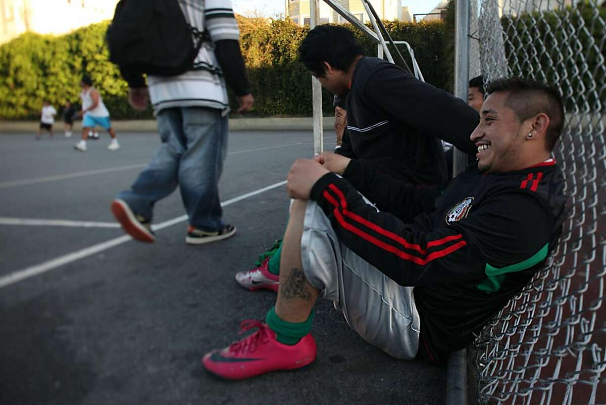 Joey Dzul, 21 years old, who's played adult soccer pick up at Mission playground in San Francisco, Calif., for the past three years, taking a break during a game on Thursday, May 11, 2011. He looks forward to the new field but doesn't mind playing on asphalt.