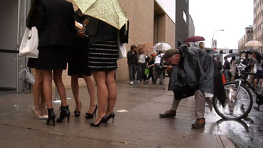 "Bill Cunningham shooting women attending a fashion show in Chelsea during Fashion Week in New York City from the feature-length documentary, ""Bill Cunningham New York,"" ( 2010),  directed by Richard Press and produced by Philip Gefter. Photo: First Thought Films"