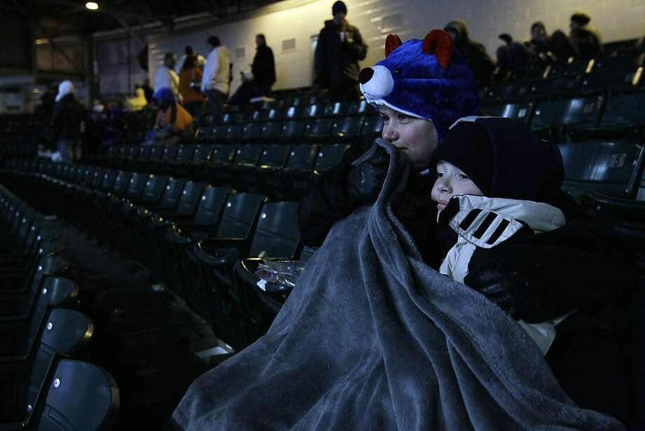 Stacy Ernst, left, and her son Johnny Ernst wait out a rain delay during a baseball game between the San Francisco Giants and the Chicago Cubs, Saturday, May 14, 2011, in Chicago. Photo: Nam Y. Huh, AP