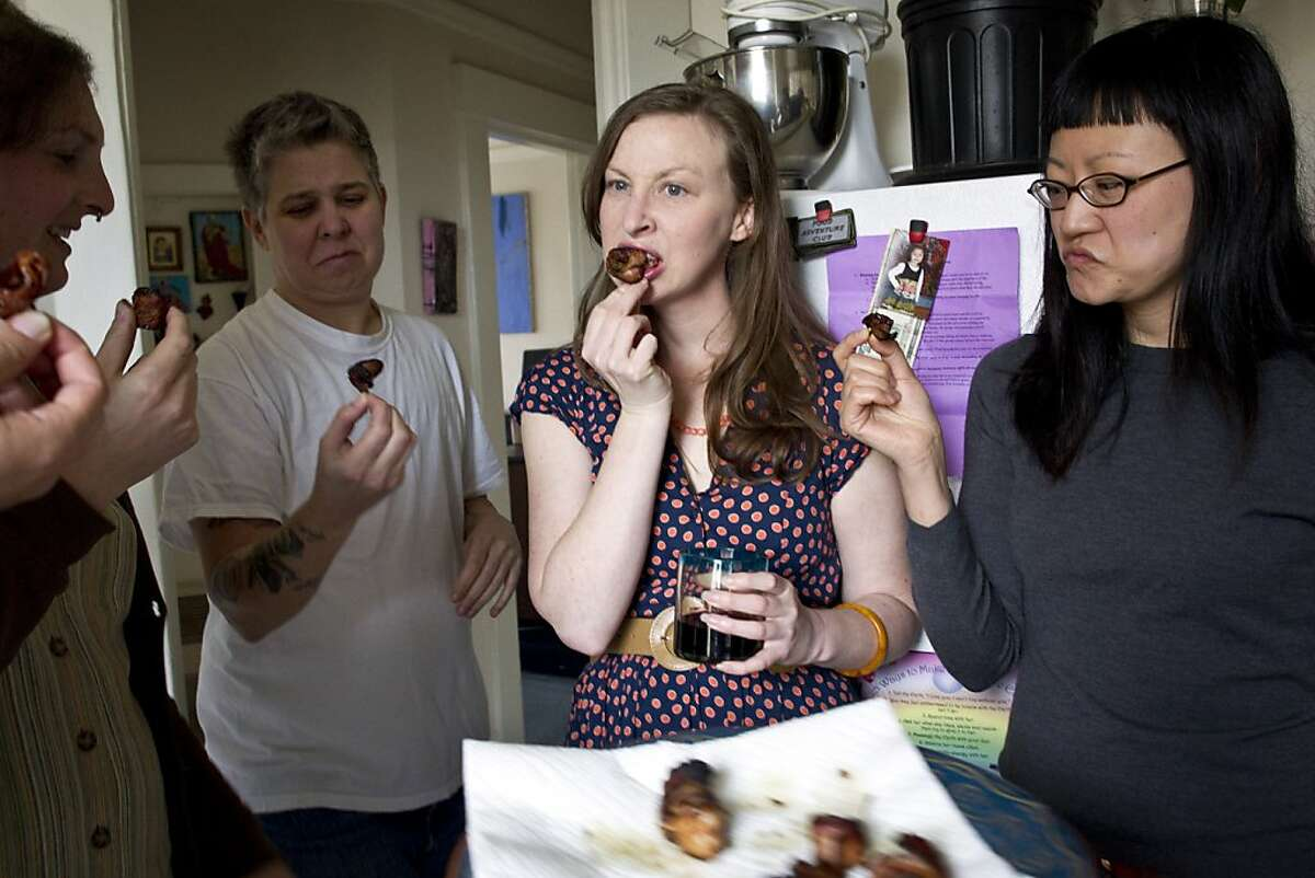 Nicki Green, Ali Liebegott, Kelly Zehnder and April Kim (left to right) taste rumaki made with human placenta during a meeting of the SF Food Adventure Club where the challenge was to eat human placenta at club founder Beth Pickens' apartment in San Francisco, Calif., on Sunday, March 13, 2011.