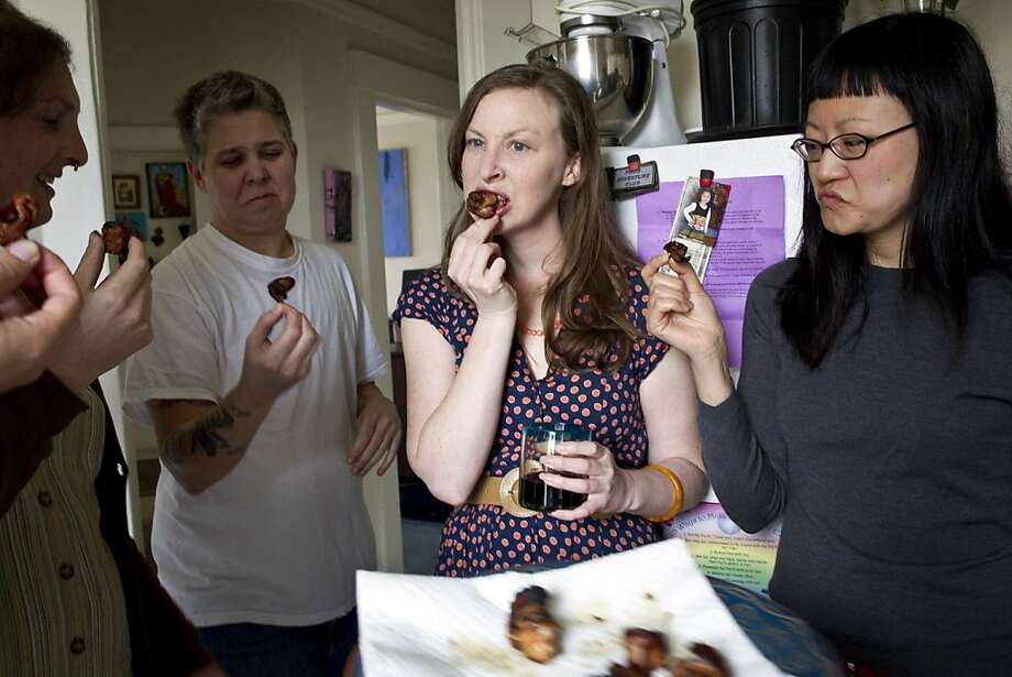 Nicki Green, Ali Liebegott, Kelly Zehnder and April Kim (left to right) taste rumaki made with human placenta during a meeting of the SF Food Adventure Club where the challenge was to eat human placenta at club founder Beth Pickens' apartment in San Francisco, Calif., on Sunday, March 13, 2011. Photo: Laura Morton, Special To The Chronicle