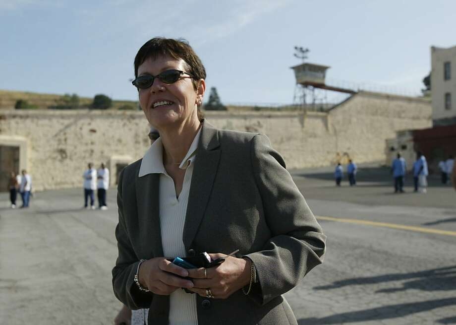 California  Department of Corrections director Jeanne Woodford walks through the Yard at San Quentin Prison, Saturday May 1, 2004. She was the warden for 25 years and this is her first  visits since leaving Feb 23, 2004, when she moved up the Sacramento to help clean-up the CDC budget problems. Photo: Lacy Atkins, The Chronicle