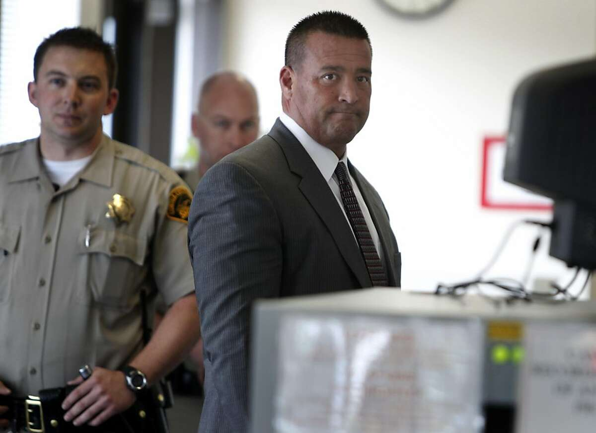 Former county sheriffs deputy Stephen Tanabe goes through security screening before a hearing at Contra Costa County Superior Court in Walnut Creek, Calif. on Thursday, April 21, 2011. Tanabe is charged with conducting several