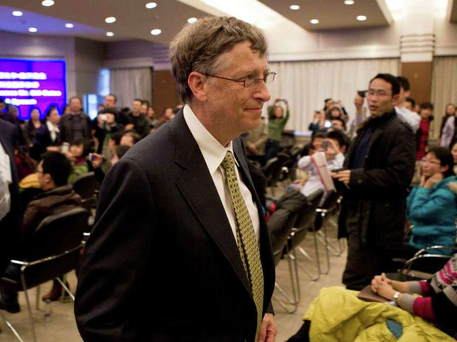 Microsoft Corp. co-founder Bill Gates leaves after he delivered a speech at the Ministry of Science and Technology in Beijing Wednesday, Dec. 7, 2011. Gates confirmed Wednesday he is in discussions with China to jointly develop a new kind of nuclear reactor. (AP Photo/Andy Wong) Photo: Andy Wong / AP