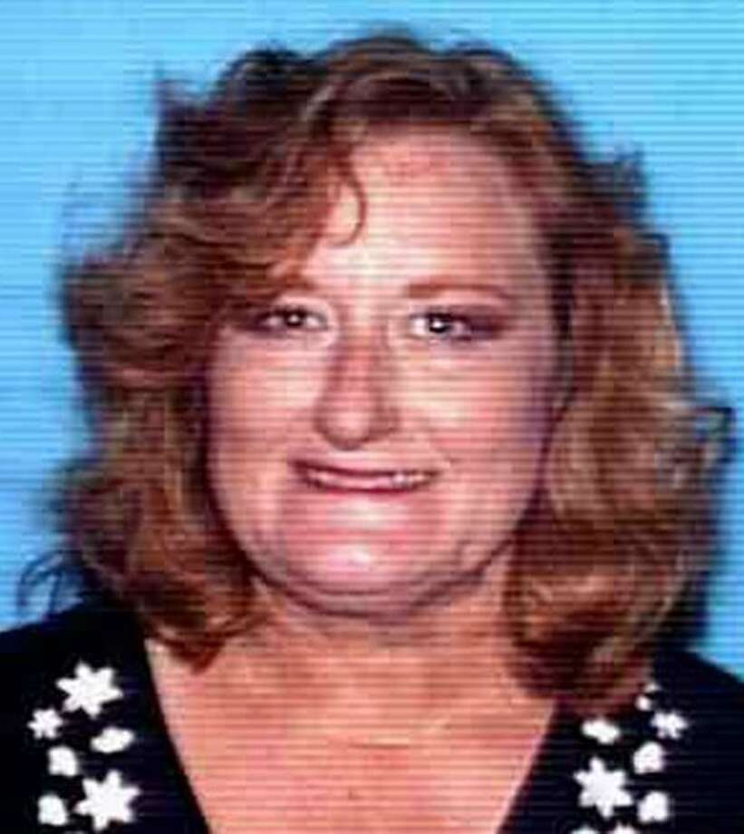 """In this photo provided Wednesday, May 11, 2011 by the Fontana Police shows Dodi Wasbotten, 51, of Fontana.  Wasbotten was arrested Wednesday on suspicion of three robberies and an attempted robbery in parking lots of department stores throughout the city. Police dubbed her the """"granny bandit."""" (AP Photo/ Fontana Police via The Sun)  LOS ANGELES TIMES OUT; VENTURA COUNTY STAR OUT; RIVERSIDE PRESS-ENTERPRISE OUT; THE VICTOR VALLEY DAILY PRESS OUT Photo: AP"""
