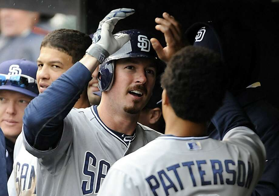San Diego Padres' Brad Hawpe celebrates his game winning two-run home run off Colorado Rockies relief pitcher Huston Street during the ninth inning of an MLB baseball game with teammate Eric Patterson on Saturday, May 14, 2011, in Denver. San Diego beat Colorado 9-7. Photo: Jack Dempsey, AP
