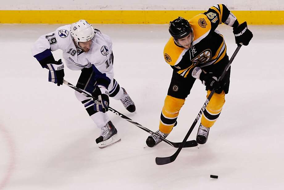 BOSTON, MA - MAY 14:  Dominic Moore #19 of the Tampa Bay Lightning and Tyler Seguin #19 of the Boston Bruins vie for the puck in the first period of Game One of the Eastern Conference Finals during the 2011 NHL Stanley Cup Playoffs at TD Garden on May 14,2011 in Boston, Massachusetts. Photo: Mike Stobe, Getty Images