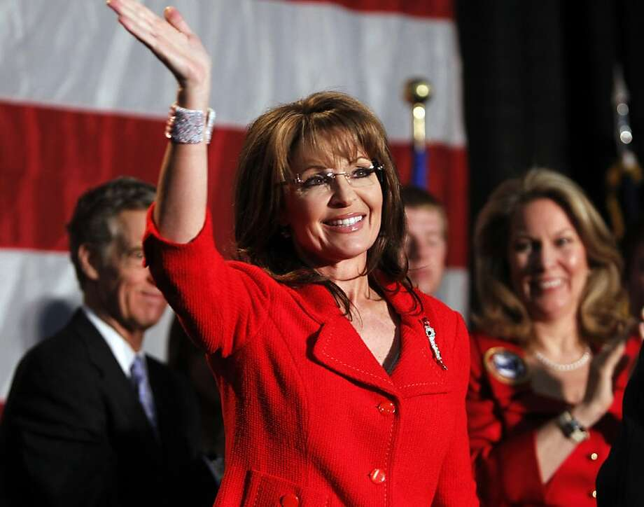Former Alaska Governor Sarah Palin waves during a fund raiser at Colorado Christian University in Lakewood, Colo., on Monday, May 2, 2011. The event raised money for a charity for families of fallen service members. Photo: Ed Andrieski, AP