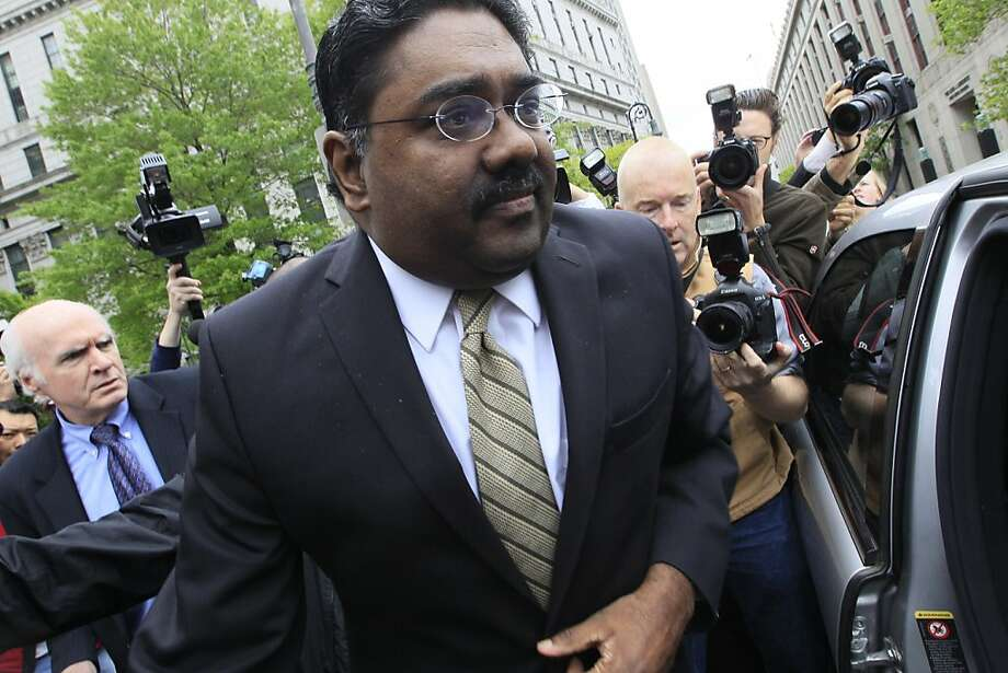 Raj Rajaratnam, center, billionaire co- founder of Galleon Group, is surrounded by photographers as leaves Manhattan federal court, with his attorney Terence Lynan, left, Wednesday, May 11, 2011 in New York. The former Wall Street titan was convicted Wednesday of making a fortune by coaxing a crew of corporate tipsters to give him an illegal edge on blockbuster trades in technology and other stocks — what prosecutors called the largest insider trading case ever involving hedge funds. Photo: Mary Altaffer, Associated Press