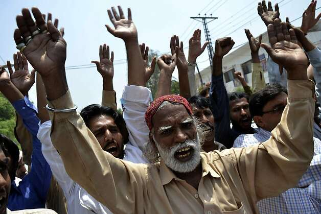 "Pakistanis shout pro-Pakistani security forces slogans during a rally in Multan on May 14, 2011. Pakistan lawmakers insisted on May 14 there must be no repeat of the US commando raid that killed Osama bin Laden and said drone strikes targeting terroristsnear the border with Afghanistan must end.  The strongly-worded message came after a parliamentary session lasting more than 10 hours, in which MPs debated the ""situation arising from unilateral US action in Abbottabad"", the northeastern garrison town where Navy SEALs shot dead the Al-Qaeda chief on May 2 after a decade-long manhunt. Photo: Str, AFP/Getty Images"