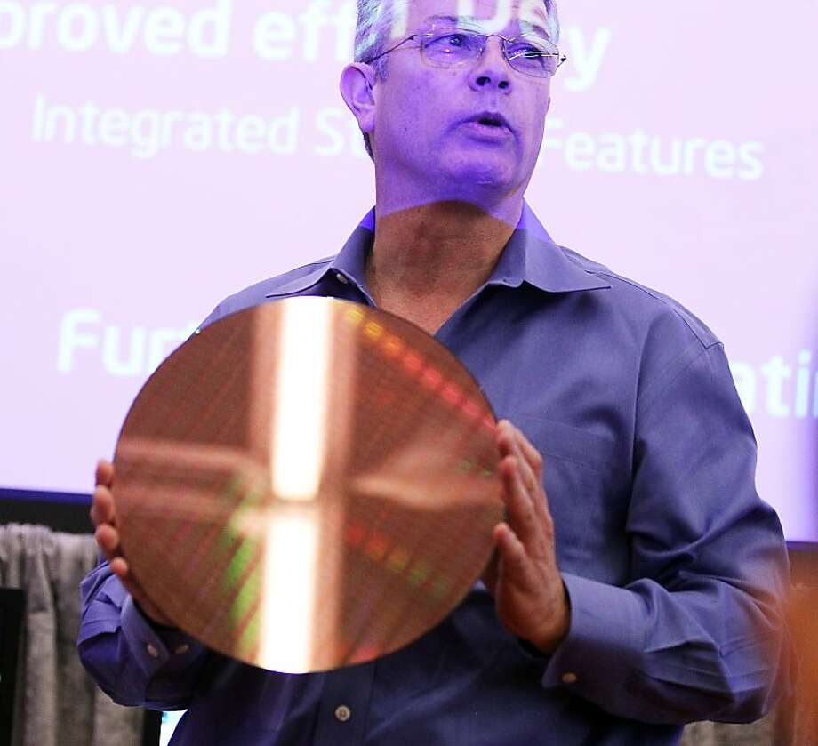 """SAN FRANCISCO, CA - MAY 04:   Intel Executive Vice President Dadi Perlmutter holds a 22 nanometer silicon wafer as he speaks during a news conference about the 3-D Tri-Gate transistors called """"Ivy Bridge"""" on May 4, 2011 in San Francisco, California. Intelannounced a technical breakthrough in the microprocessors with the world's first Tri-Gate transistors, that will increase speed and consume less energy. Photo: Justin Sullivan, Getty Images"""