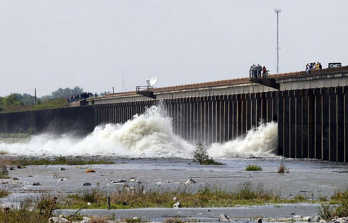 Water diverted from the Mississippi River spills through a bay in the Morganza Spillway in Morganza, La., Saturday, May 14, 2011. A steel, 10-ton floodgate was slowly raised Saturday for the first time in nearly four decades, unleashing a torrent of waterfrom the Mississippi River, away from heavily populated areas downstream.