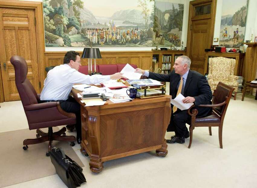 Gov. Dan Malloy sits in his office with Mark Ojakian, chief negotiator with the unions, at the state Capitol in Hartford, Conn. on Tuesday May 17, 2011.