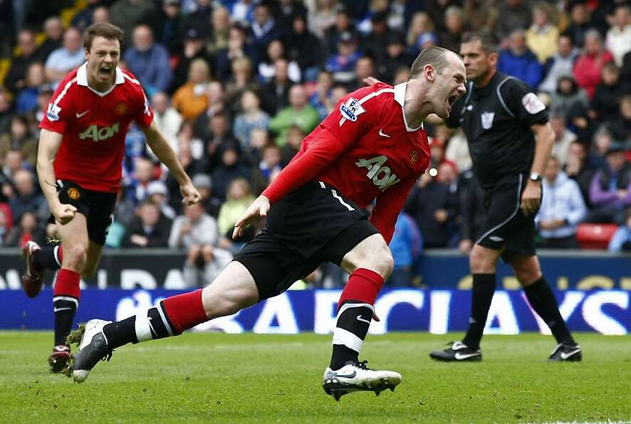 Manchester United's Wayne Rooney, center, celebrates after scoring a penalty goal against Blackburn