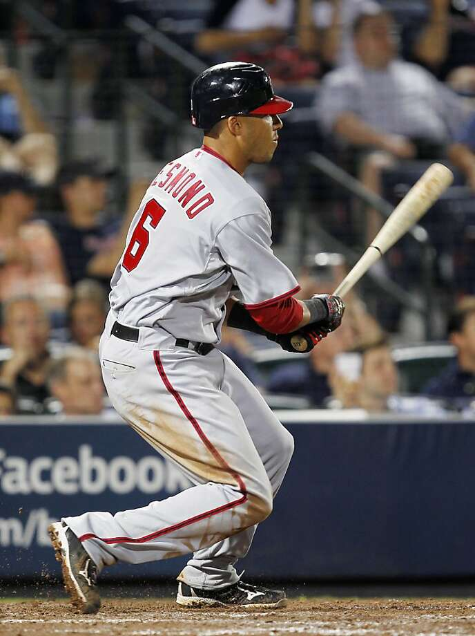 Washington Nationals' Ian Desmond watches his two-run double in the 11th inning of a baseball game against the Atlanta Braves on Wednesday, May 11, 2011, in Atlanta. Washington won 7-3. Photo: John Bazemore, AP