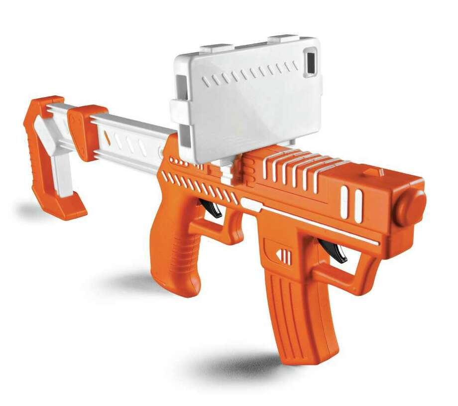 This product photo provided by Spin Master Ltd, shows the Appblaster. The $19.99 AppBlaster, a plastic gun for kids over 8 years old. After slipping an iPhone or iPad touch on top of the AppBlaster, kids can shoot at aliens that pop up on the screen. (AP Photo/Spin Master Ltd, Tom Szuba) Photo: Tom Szuba / Spin Master Ltd