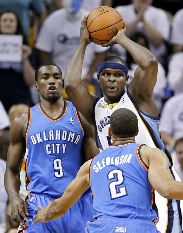 Memphis Grizzlies forward Zach Randolph, top right, looks for a teammate as he is defended by Oklahoma City Thunder forward Serge Ibaka (9) and Thabo Sefolosha (2), of Switzerland, during the first half of Game 6 of a second-round NBA basketball playoff series on Friday, May 13, 2011, in Memphis, Tenn. Photo: Lance Murphey, AP
