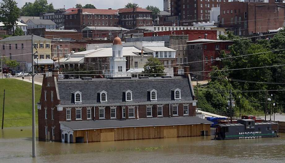 Mississippi flood waters creep up the Old Train Depot and flood walls of downtown Vicksburg, Miss., Friday, May 13, 2011. Mississippi River flooding is expected on both sides of the river along the tributaries that are being backed up onto communities, farm lands and businesses. The water level is not expected to crest in Vicksburg until Thursday. Photo: Rogelio V. Solis, AP