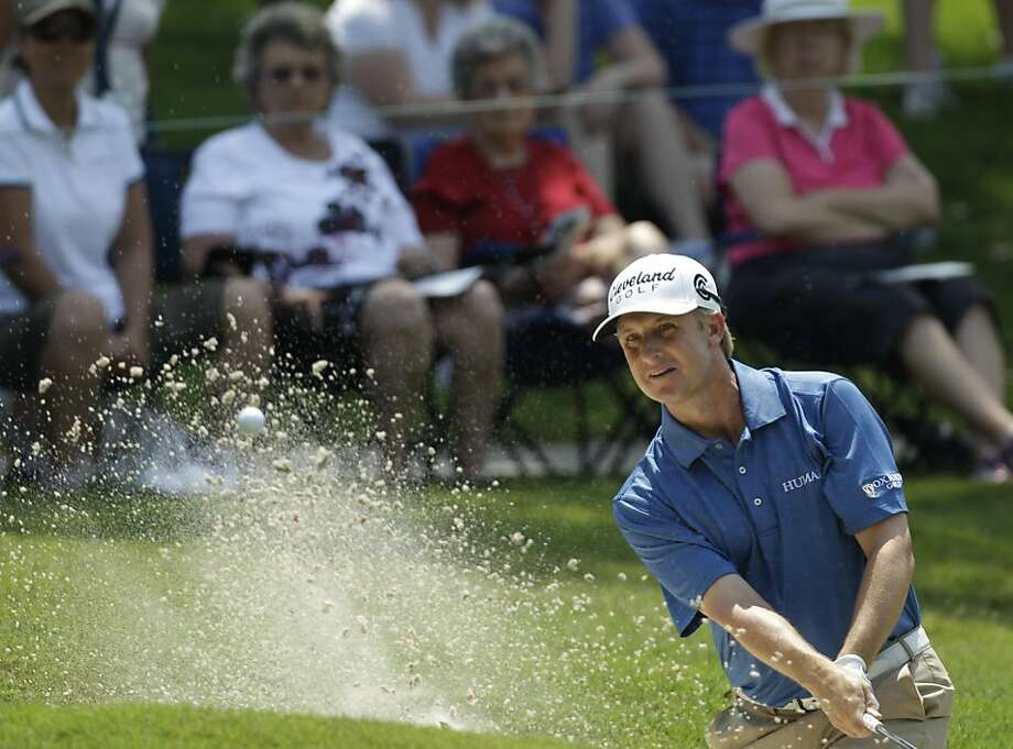 David Toms hits from the sand on the 15th hole during the second round of The Players Championship golf tournament, Friday, May 13, 2011, in Ponte Vedra Beach, Fla. Toms finished with a two-round score of 10-under-par. Photo: Chris O'Meara, AP