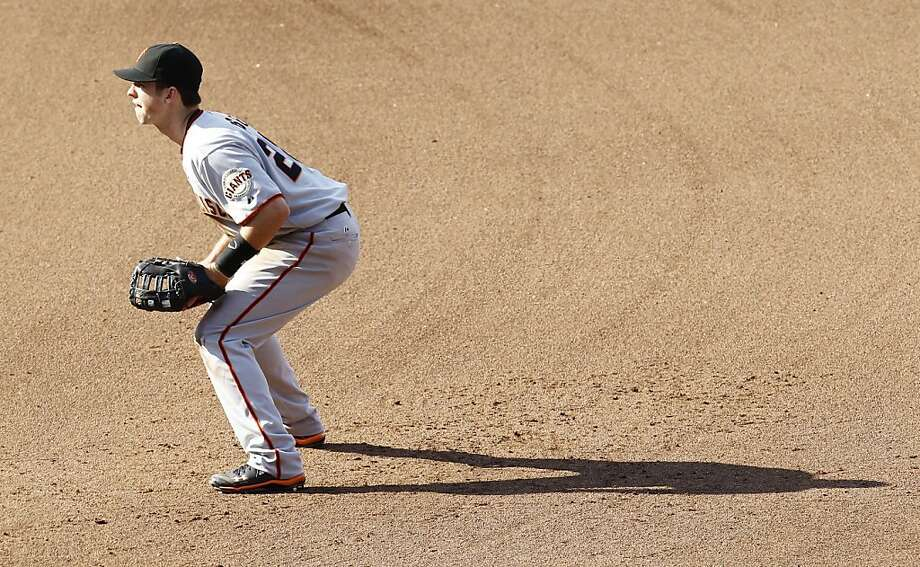San Francisco Giants' Buster Posey plays first base during the fourth inning of an MLB baseball game against the Washington Nationals, Saturday, April 30, 2011 in Washington. The Giants won 2-1. Photo: Luis Alvarez, AP