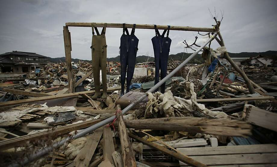 Fishermen's overall suits are hanged in an area destroyed by the March 11 earthquake and tsunami in Kesennuma, northeastern Japan, Tuesday, May 10, 2011. Photo: Junji Kurokawa, AP