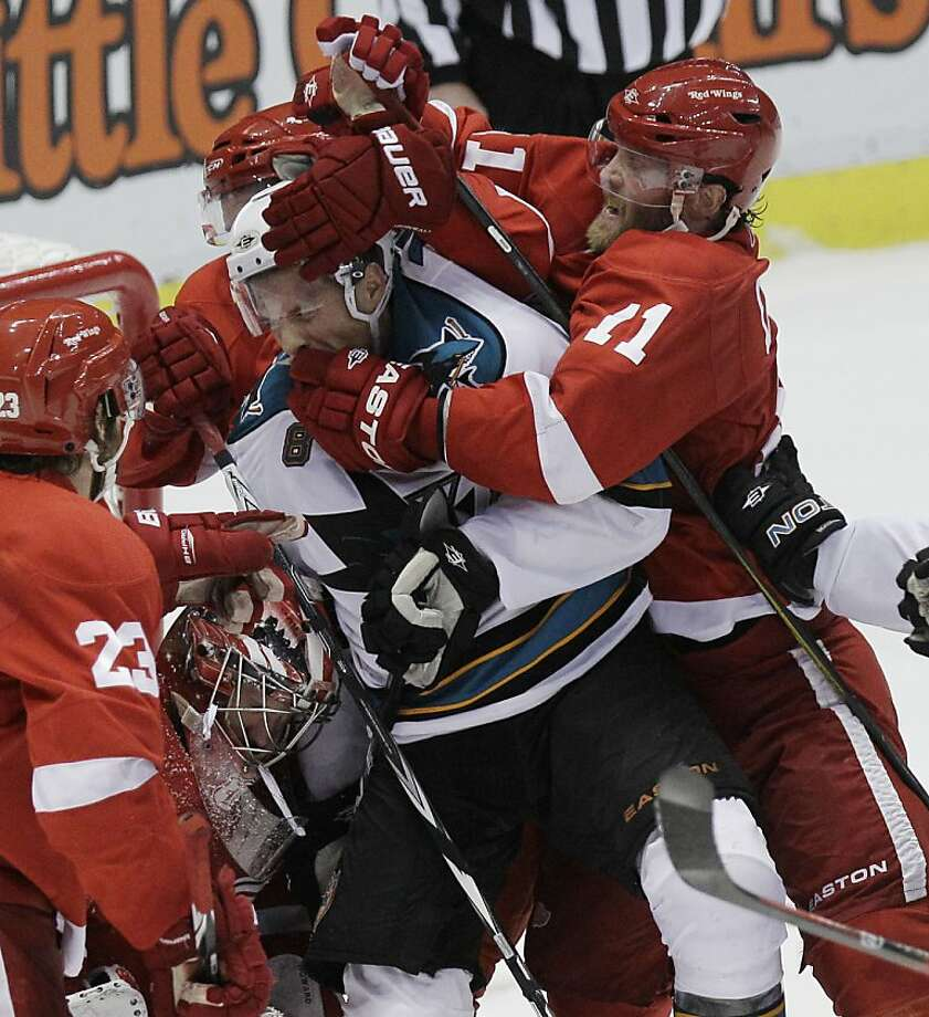 Detroit Red Wings winger Dan Cleary (11) checks San Jose Sharks center Joe Pavelski (8) in front of the net during the third period in Game 6 of a second-round NHL Stanley Cup playoffs hockey game in Detroit, Tuesday, May 10, 2011. Photo: Carlos Osorio, AP