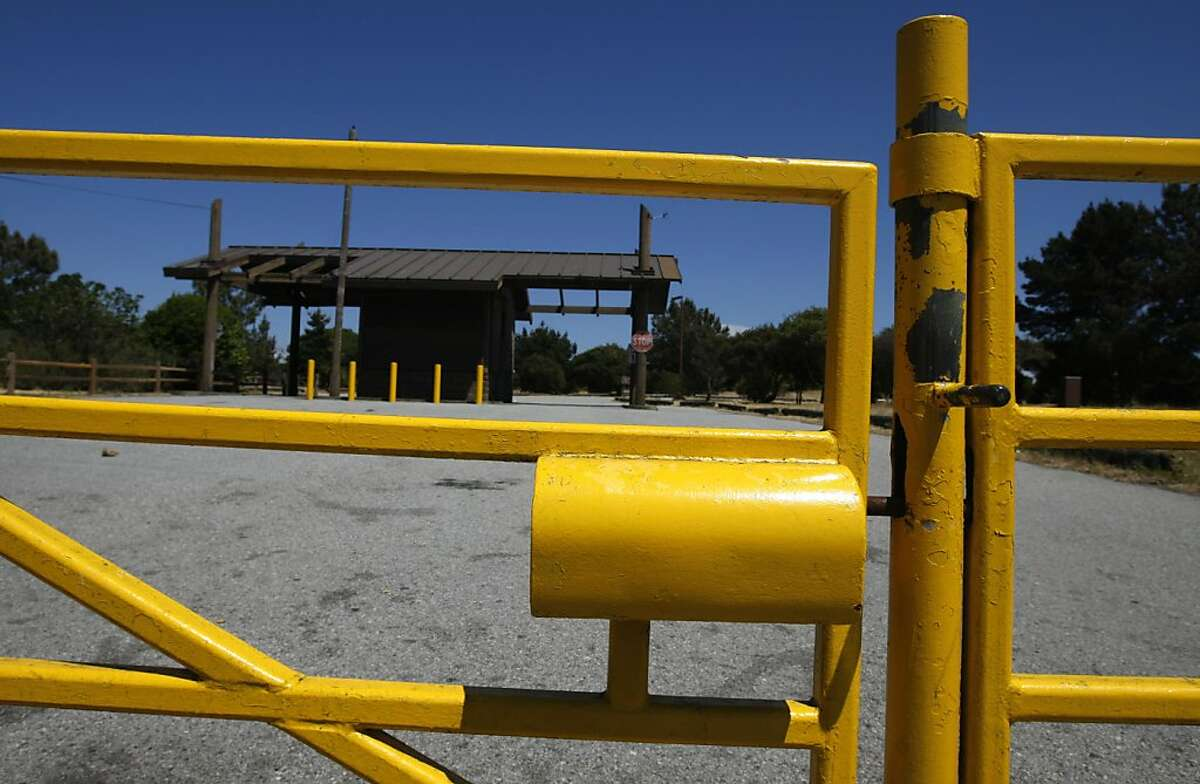 The entrance to the Candlestick Point State Recreation Area is locked in San Francisco, Calif. on Friday, May 13, 2011. The parkland, situated across from Candlestick Park, is among the 70 state parks that will close in September as a result of budget cuts.