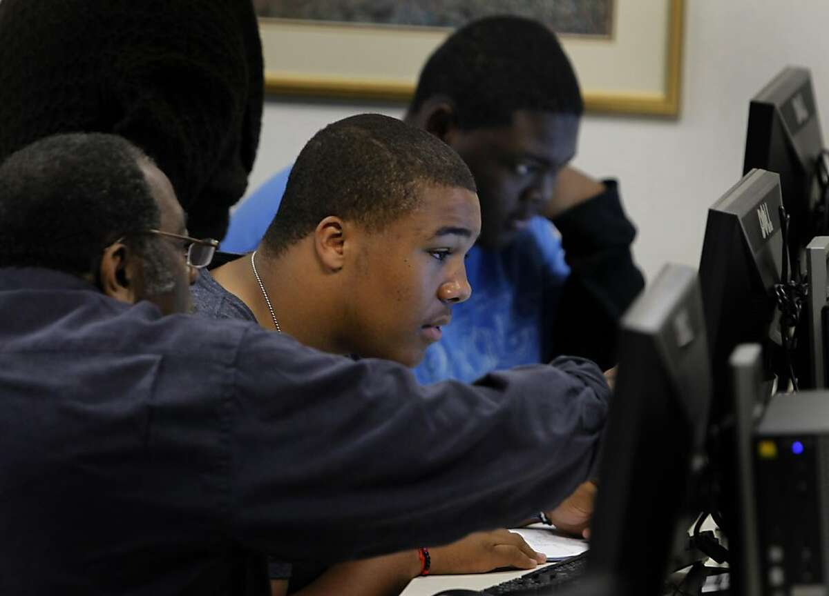 Berkeley Tech students Elliott Spillard (center) and Anthony Johnson (right) search for records on their ancestry in the Family History Center at the Mormon Temple in Oakland, Calif. on Thursday, May 12, 2011.