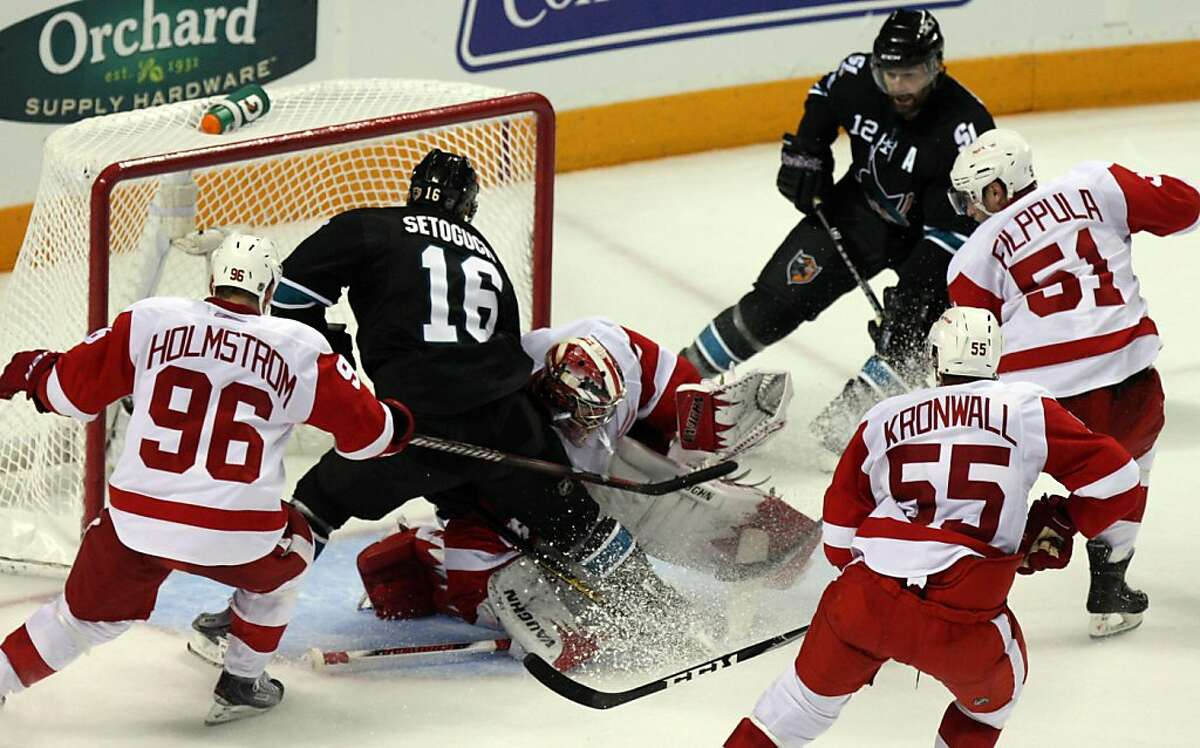 San Jose Sharks Patrick Marleau (12) right scores the winning goal against the Detroit Red Wings in the third period of Game 7 of a second-round NHL Stanley Cup playoff hockey game in San Jose California, Thursday May 12, 2011. Sharks win 3-2 to take the series.