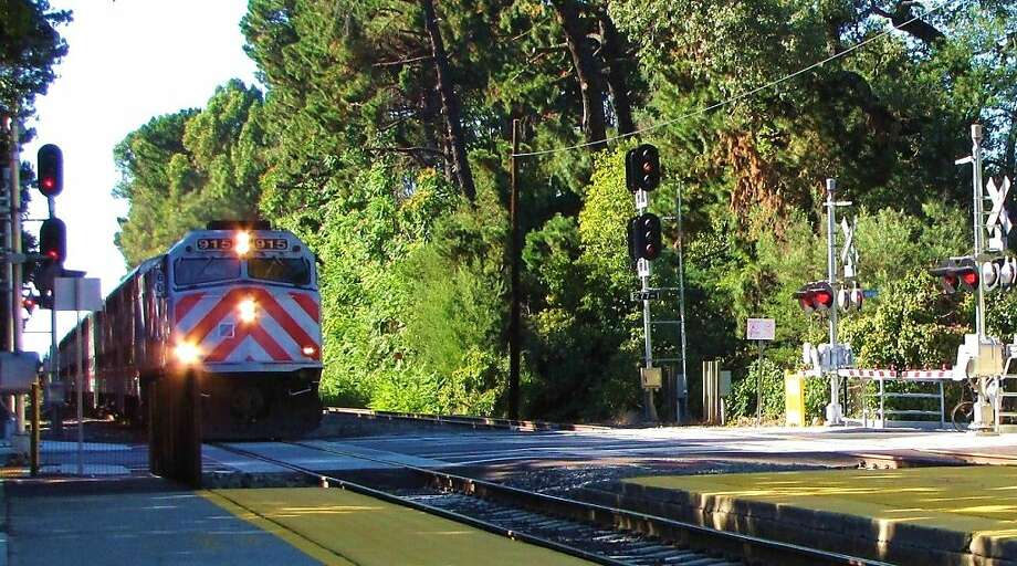 In this file photo a Caltrain arrvies at the Atherton Caltrain Station. The town of Atherton filed suit Monday to halt Caltrain's electrification project. Photo: Stephanie Wright Hession