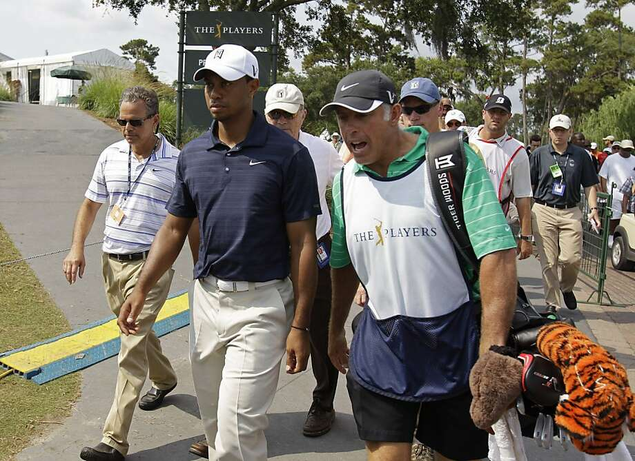 Tiger Woods, second from left,  and his caddie Steve Williams leave the course after nine holes during the first round of The Players Championship golf tournament Thursday May 12, 2011,  in Ponte Vedra Beach, Fla. Woods withdrew after playing nine holes and shooting a 42. Photo: Chris O'Meara, AP