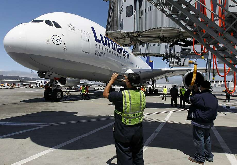 Ground crew personnel snap photos of a Lufthansa Airbus A380 super jumbo jet, the world's largest passenger aircraft, after its arrival at SFO on Tuesday after a flight from Frankfurt, Germany. Photo: Paul Chinn, The Chronicle
