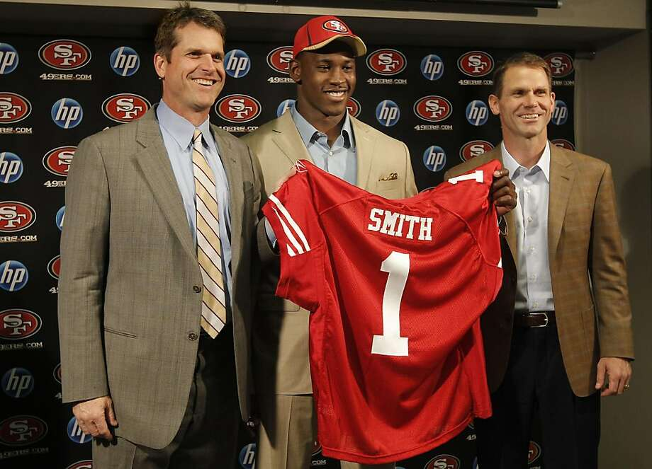 49ers head coach Jim Harbaugh, (left) and general manager, Trent Baalke, (right) introduce Aldon Smith, the The San Francisco 49ers' first round NFL draft pick, at 49ers headquarters in Santa Clara, Ca., on Friday April 29, 2011. Photo: Michael Macor, The Chronicle