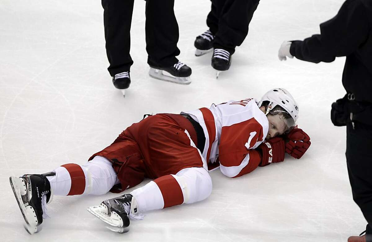 Detroit Red Wings right wing Daniel Cleary lies on the ice after he was hurt during the second period against the San Jose Sharks in Game 7 of an NHL hockey Stanley Cup Western Conference semifinal playoff series Thursday, May 12, 2011, in San Jose, Calif.