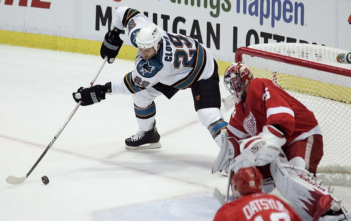 San Jose Sharks' Ryane Clowe (29) takes a shot against Detroit Red Wings goalie Jimmy Howard the first period in Game 4 of a second-round NHL Stanley Cup playoffs hockey series, Friday, May 6, 2011, in Detroit.