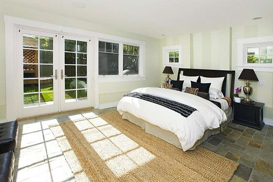 Located on the lower level, the master bedroom opens to the yard via French doors. Photo: Steph Dewey, Reflex Imaging