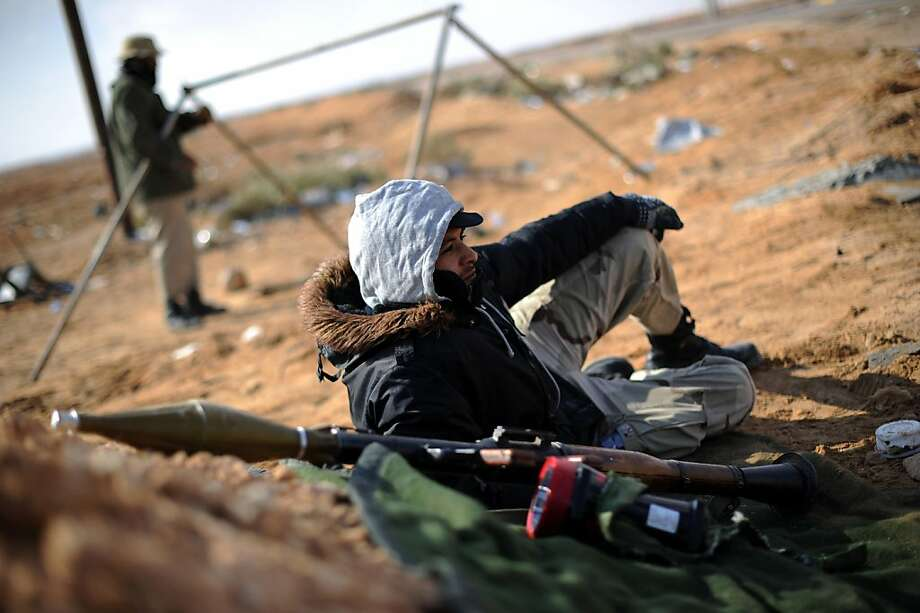 A Libyan rebel rests at a checkpoint before going to the front line on the outskirts of the eastern city of Ajdabiya, between the rebel-held east and the mainly government-held west, on May 12, 2011. Photo: Saeed Khan, AFP/Getty Images