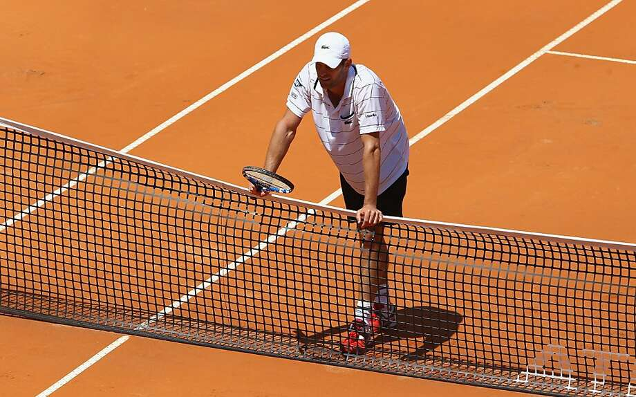ROME, ITALY - MAY 09:  Andy Roddick of the USA shows his dejection as he leans on the net during his first round match against Gilles Simon of France during day two of the Internazoinali BNL D'Italia at the Foro Italico Tennis Centre on May 9, 2011 in Rome, Italy. Photo: Clive Brunskill, Getty Images