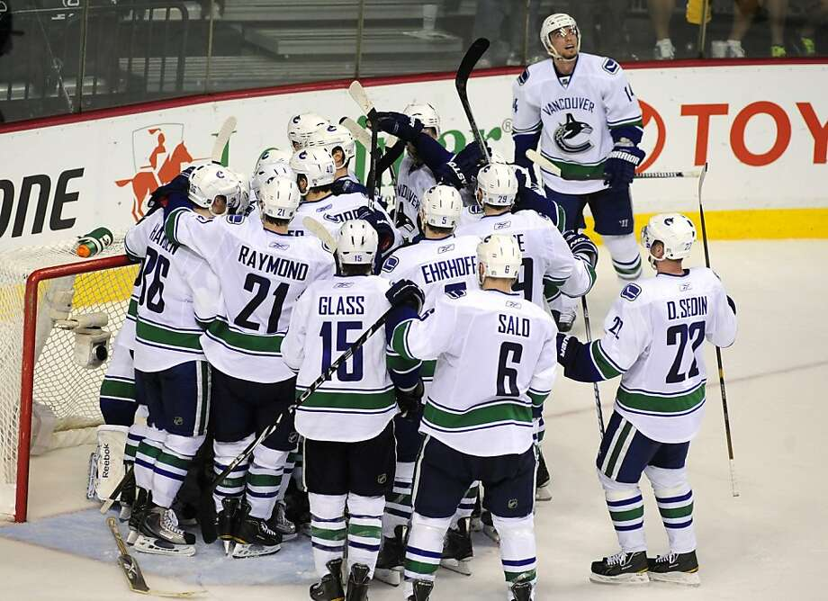 The Vancouver Canucks celebrate their 2-1 win in Game 6 of a second-round NHL Stanley Cup playoff hockey series against the Nashville Predators, Monday, May 9, 2011, in Nashville, Tenn. Vancouver advanced to the conference finals. Photo: Mike Strasinger, AP