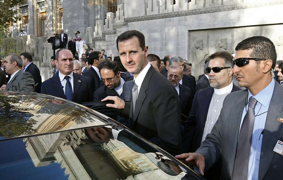FILE - In this Oct. 2, 2010 file photo, Syrian President Bashar Assad, center, leaves after he is awarded with Iran's highest national medal by his Iranian counterpart Mahmoud Ahmadinejad, in a ceremony in Tehran, Iran.  Assad, who was awarded Iran's highest national medal for his support to Palestinian militants and Hezbollah in Lebanon, offered dim hopes Saturday for any success in Middle East peace talks, saying the White House is only using its mediation between Israelis and Palestinians to score political points in the United States. Photo: Vahid Salemi, AP