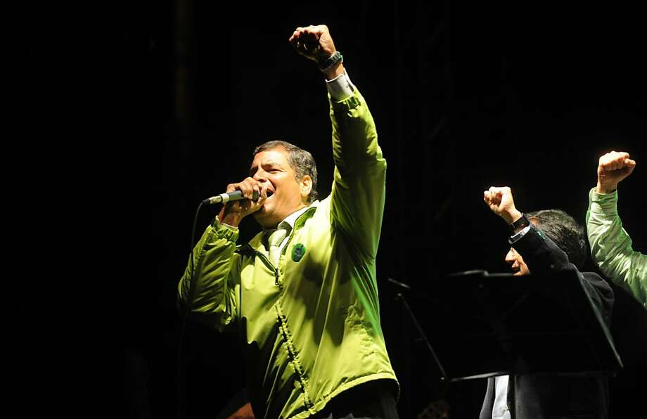 Ecuadorean President Rafael Correa gestures as he celebrates after a fast count, by the National Electoral Council, of the votes of a referendum launched by him on May 7, 2011. Photo: Raul Arboleda, AFP/Getty Images