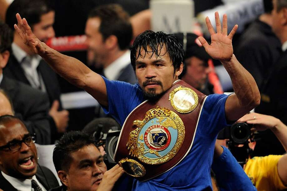 LAS VEGAS, NV - MAY 07:  Manny Pacquiao of the Philippines celebrates after his unanimous decision victory against Shane Mosley in the WBO welterweight title fight at MGM Grand Garden Arena on May 7, 2011 in Las Vegas, Nevada. Photo: Ethan Miller, Getty Images