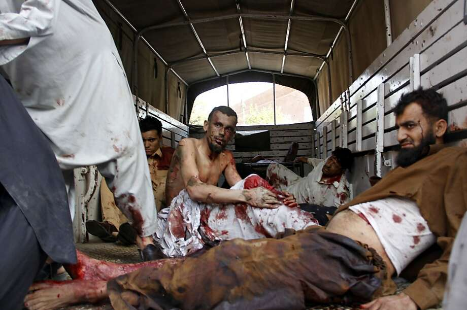 Wounded blast victims lie on the flatbed of a truck as they wait for help outside a hospital in Peshawar on May 13, 2011, following a suicide and bomb attack on paramilitary police in the northwestern town of Shabqadar. Pakistan's Taliban on May 13 claimed their first major attack to avenge Osama bin Laden's death as 80 people were killed in a double suicide bombing on a paramilitary police training centre. Around 140 people were wounded, 40 of them fighting for their lives, in the deadliest attack this year in the nuclear-armed country, where the government is deep in crisis over the killing of the Al-Qaeda chief by US forces on May 2. Photo: Strdel, AFP/Getty Images