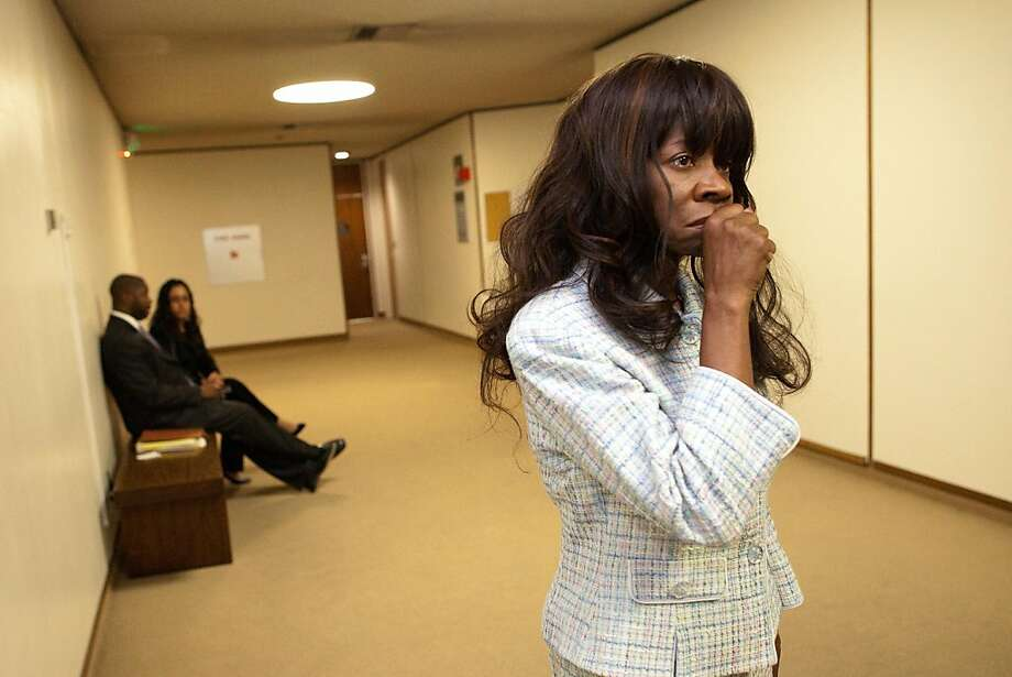 Jynona Norwood, (R) and her attorney Vernon Goins II wait to go inside the courtroom of the Alameda County Court on May 12, 2011 in Oakland, Calif. Photograph by David Paul Morris/Special to the Chronicle Photo: David Paul Morris, Special To The Chronicle