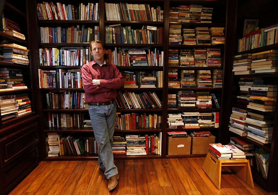 Mark Coker stands in his personal library on the Peninsula. Coker became frustrated when publishers wouldn't buy his novel, so he used his Silicon Valley startup background to create a tech company that would help other aspiring writers to turn their works into e-books. Today Smashwords is the leading site for people who want to self-publish anything from vampire novels to family histories, and has tens of thousands of e-books for sale on its own site and through other online retailers like Barnes & Noble. Wednesday May, 4, 2011 Photo: Lance Iversen, The Chronicle