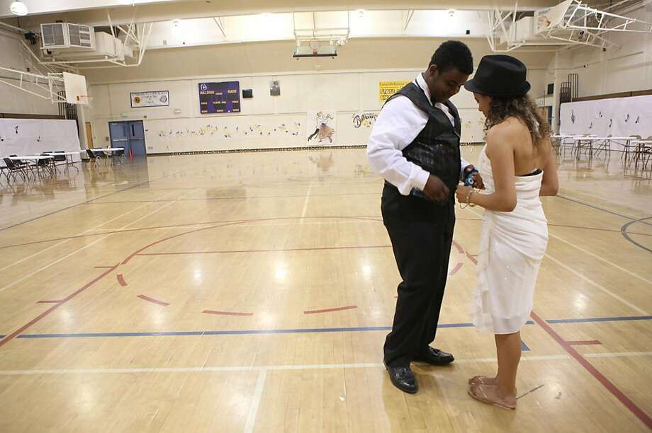 Ninth graders Desean Moore (left), 14 years old, and Colleen Burkhart (right), 15 years old, are one of the last to leave the girls gym at Oakland Technical high school in Oakland, Calif., after a night of ballroom dancing on Thursday,  May 5, 2011. Photo: Liz Hafalia, The Chronicle